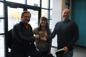 LiveRez CEO Tracy Lotz gives Utopian LVH  its custom copper partner medallion on Tuesday.