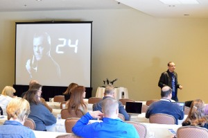 LiveRez's Brian Sevy plays Jack Bauer in the company's 24-themed workshop on housekeeping and maintenance.